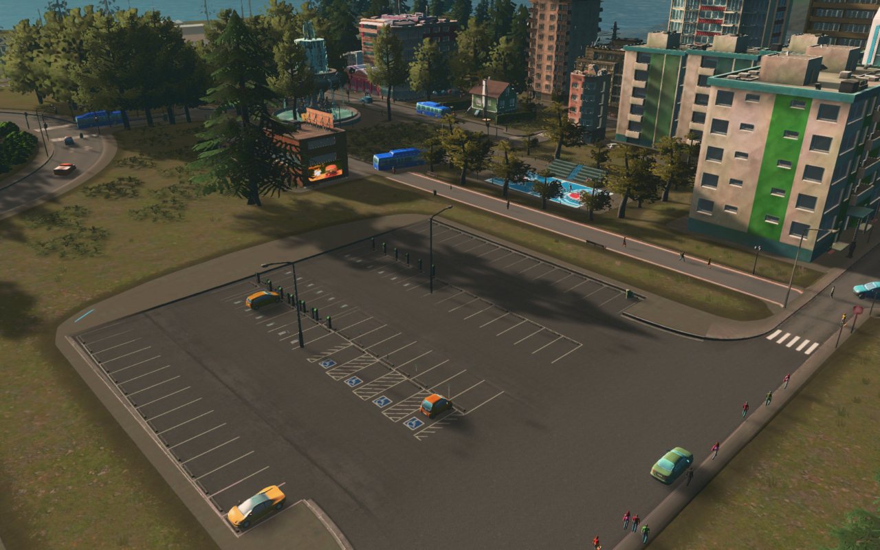 A deserted parking lot in a newly built area.
